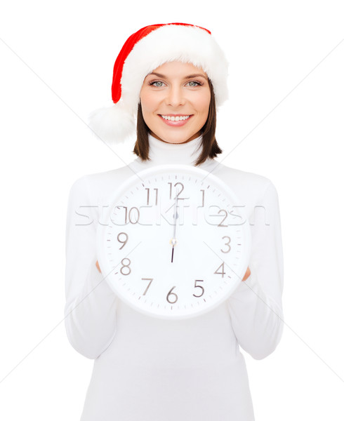 woman in santa helper hat with clock showing 12 Stock photo © dolgachov