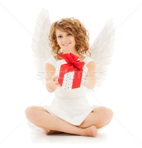 happy teenage angel girl with christmas gift Stock photo © dolgachov