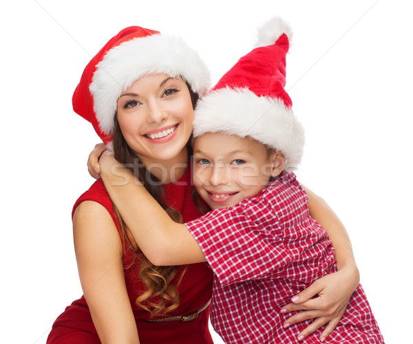 happy mother and child boy in santa helper hats Stock photo © dolgachov