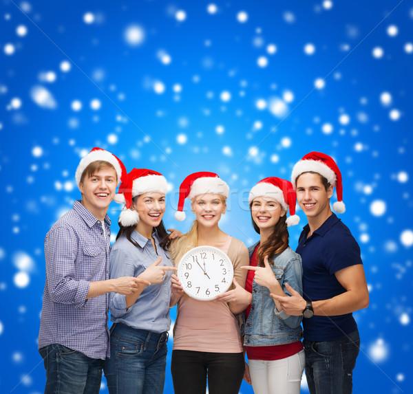группа улыбаясь студентов часы 12 Сток-фото © dolgachov