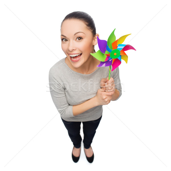 smiling asian woman with windmill Stock photo © dolgachov