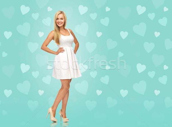 woman in white dress over blue background Stock photo © dolgachov