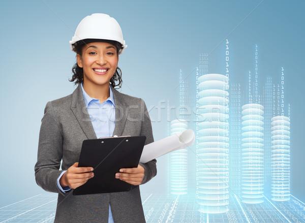 businesswoman in white helmet with clipboard Stock photo © dolgachov