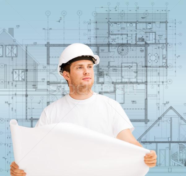 Férfi építész néz terv épület fejlődő Stock fotó © dolgachov