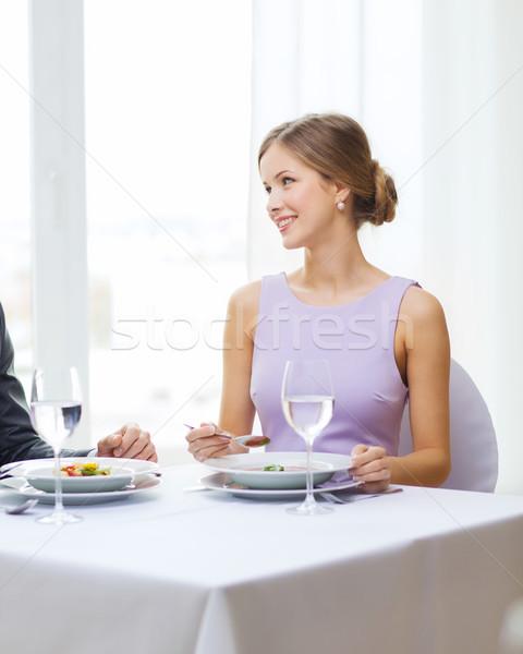 young woman looking at husband or boyfriend Stock photo © dolgachov
