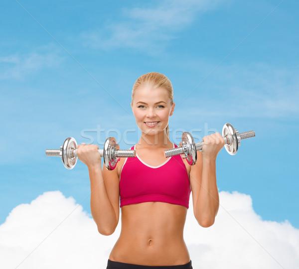 Donna sorridente acciaio manubri fitness sanitaria Foto d'archivio © dolgachov