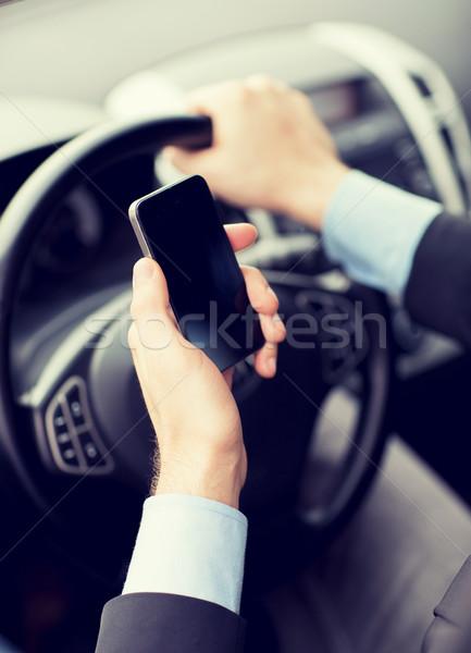 Uomo telefono guida auto transporti veicolo Foto d'archivio © dolgachov