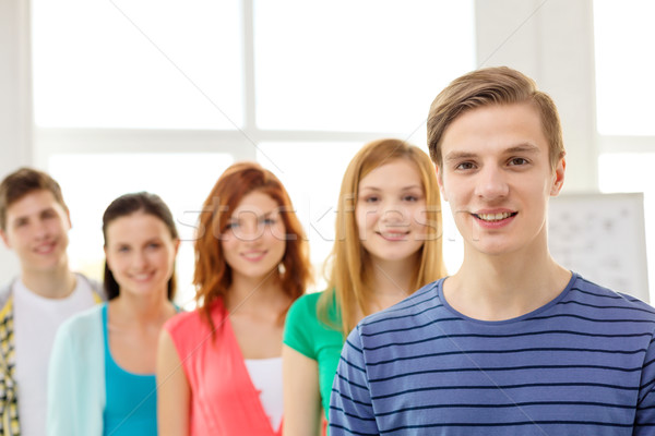 Lächelnd Studenten Teenager Vorderseite Bildung Schule Stock foto © dolgachov