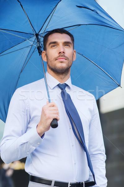 Genç ciddi işadamı şemsiye açık havada iş Stok fotoğraf © dolgachov