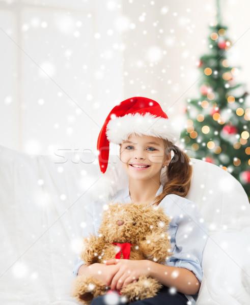 笑みを浮かべて 少女 サンタクロース ヘルパー 帽子 テディベア ストックフォト © dolgachov