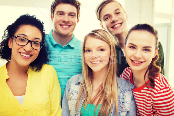 group of smiling people at school or home Stock photo © dolgachov