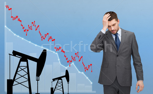 businessman with forex chart and pumpjacks Stock photo © dolgachov