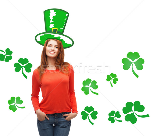 smiling teen girl in green top hat with shamrock Stock photo © dolgachov