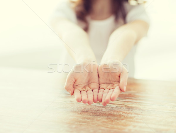close up of little girl showing empty cupped hands Stock photo © dolgachov