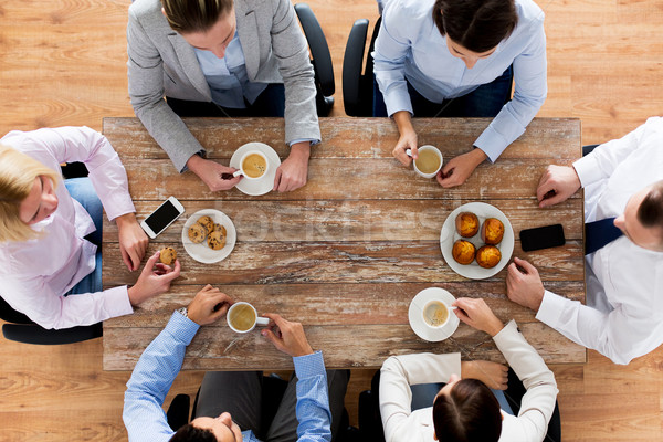 close up of business team drinking coffee on lunch Stock photo © dolgachov
