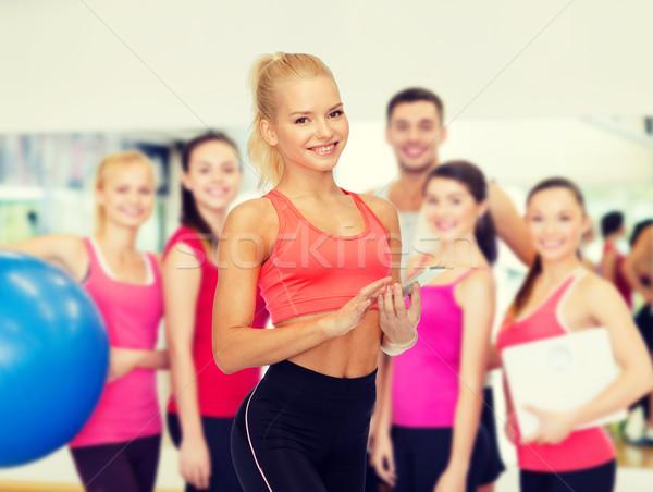 Stock fotó: Mosolyog · sportos · nő · okostelefon · sport · fitnessz