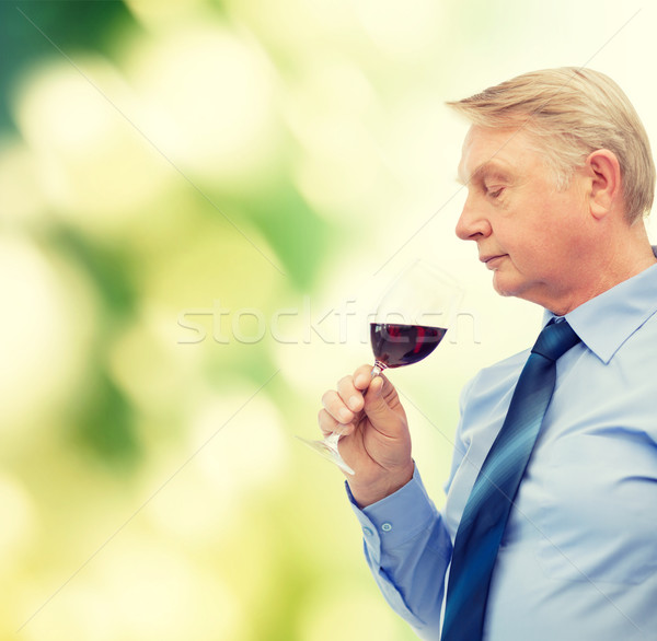 elderly man smelling red wine Stock photo © dolgachov