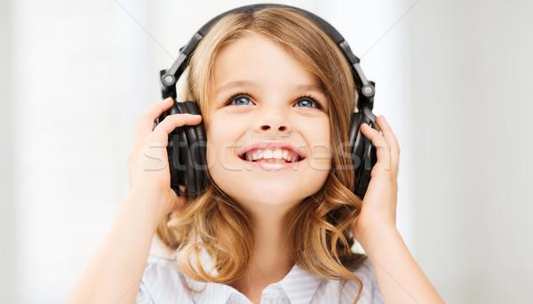 девочку наушники домой технологий музыку девушки Сток-фото © dolgachov