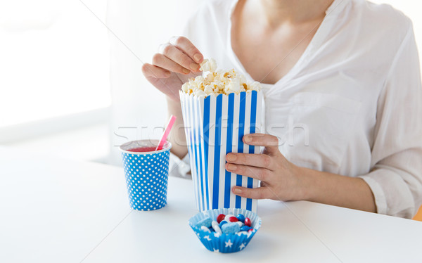 woman eating popcorn with drink and candies Stock photo © dolgachov