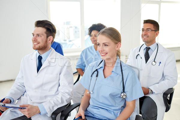 Grupo feliz médicos seminário hospital profissão Foto stock © dolgachov