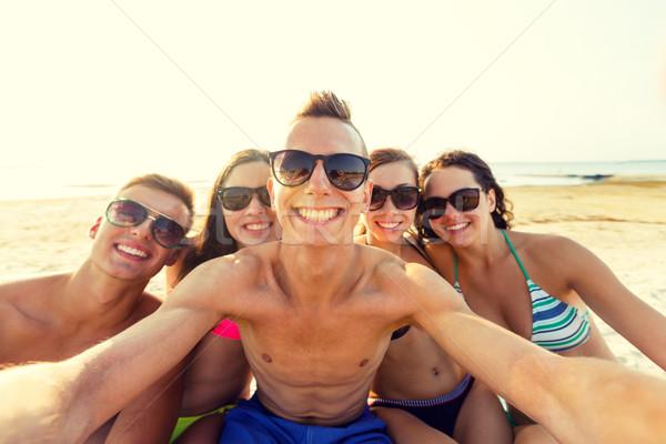 ストックフォト: グループ · 笑みを浮かべて · 友達 · ビーチ · 友情