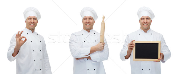 happy male chef baker with menu board showing ok Stock photo © dolgachov