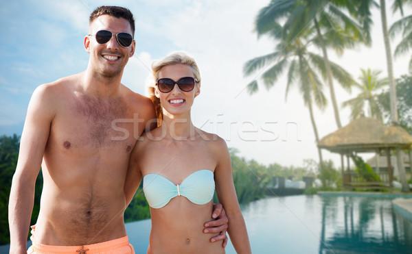 happy couple in swimwear hugging over hotel resort Stock photo © dolgachov