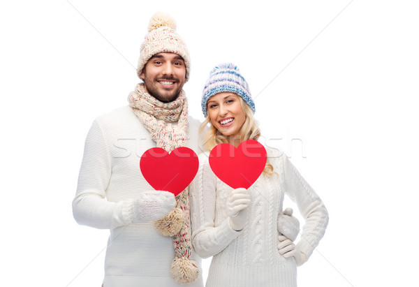 smiling couple in winter clothes with red hearts Stock photo © dolgachov
