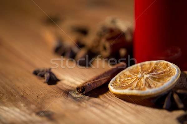 cinnamon, anise and dried orange on wooden board Stock photo © dolgachov
