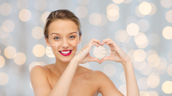улыбаясь формы сердца рукой знак красоту Сток-фото © dolgachov