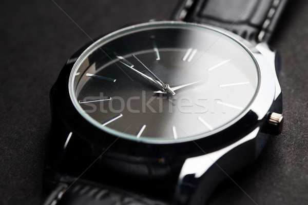 close up of black classic male wristwatch Stock photo © dolgachov