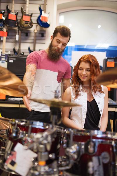 Man vrouw trommel uitrusting muziek store Stockfoto © dolgachov