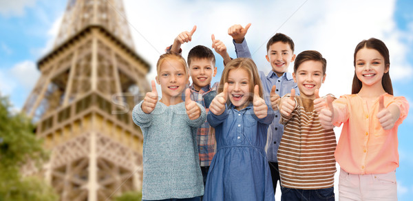 happy children showing thumbs up over eiffel tower Stock photo © dolgachov