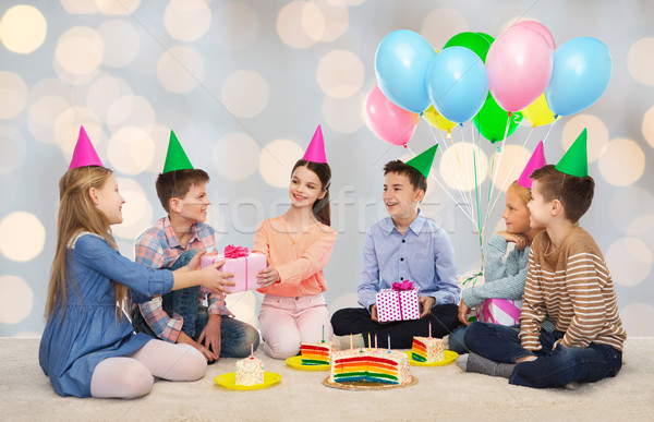 happy children giving presents at birthday party Stock photo © dolgachov
