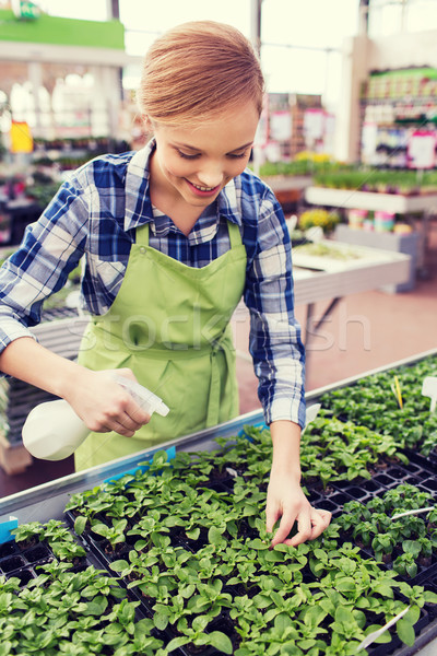 woman with sprayer and seedling in greenhouse Stock photo © dolgachov