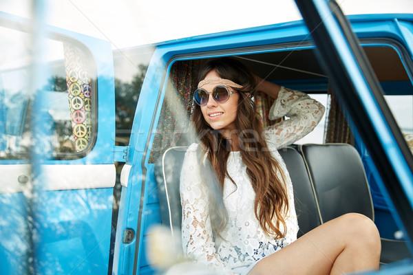 smiling young hippie woman in minivan car Stock photo © dolgachov