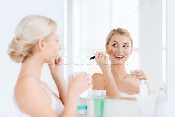woman with makeup brush and powder at bathroom Stock photo © dolgachov