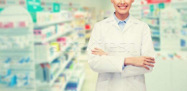 Jonge vrouw apotheker drogist apotheek geneeskunde mensen Stockfoto © dolgachov