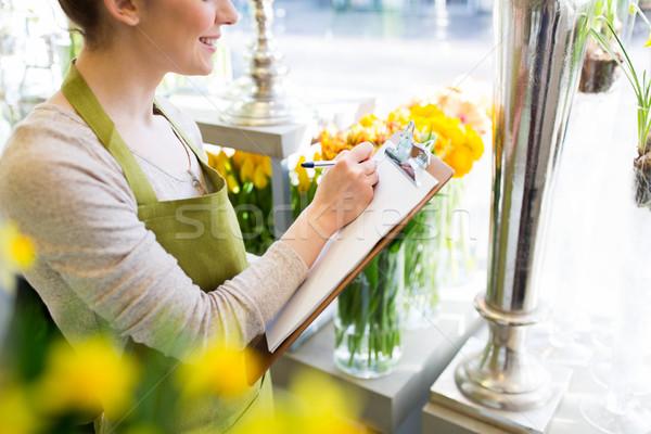 Közelkép nő vágólap virágüzlet emberek vásár Stock fotó © dolgachov