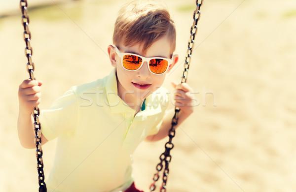 Boldog kicsi fiú hinta játszótér nyár Stock fotó © dolgachov
