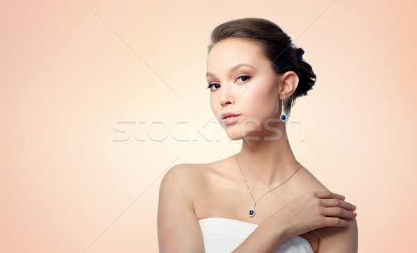 beautiful asian woman with earring and pendant Stock photo © dolgachov