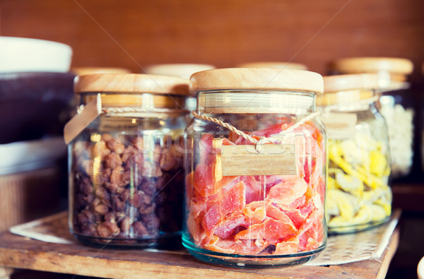 close up of jars with dried fruits at grocery Stock photo © dolgachov