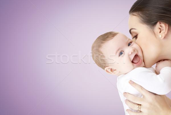 happy mother kissing adorable baby Stock photo © dolgachov