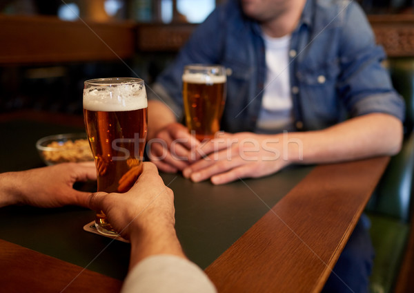 close up of men drinking beer at bar or pub Stock photo © dolgachov