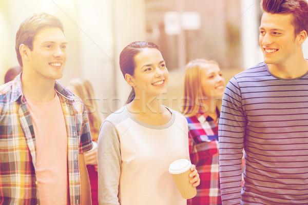 Grupo sonriendo estudiantes papel las tazas de café educación Foto stock © dolgachov