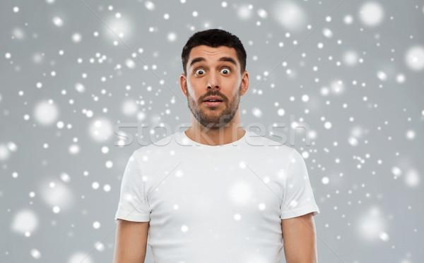 Peur homme blanche tshirt neige émotion Photo stock © dolgachov