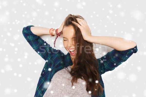 Gelukkig tienermeisje hoofd sneeuw winter Stockfoto © dolgachov