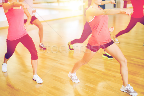 group of smiling people exercising in the gym Stock photo © dolgachov