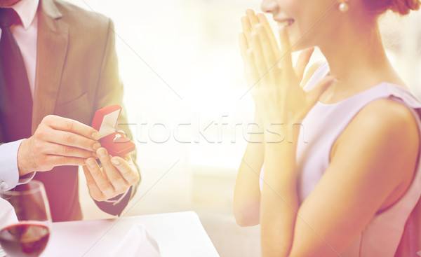 excited young woman and boyfriend giving her ring Stock photo © dolgachov