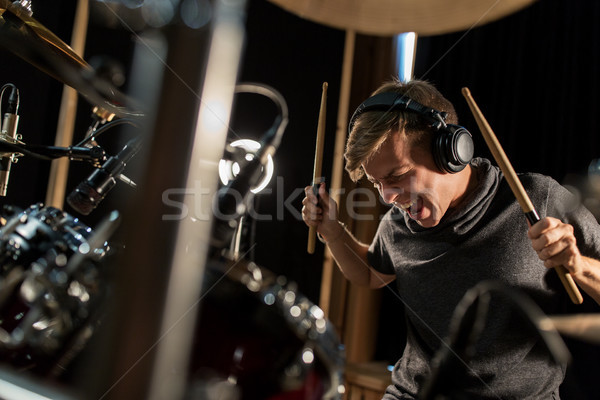 мужчины музыканта играет барабаны концерта музыку Сток-фото © dolgachov